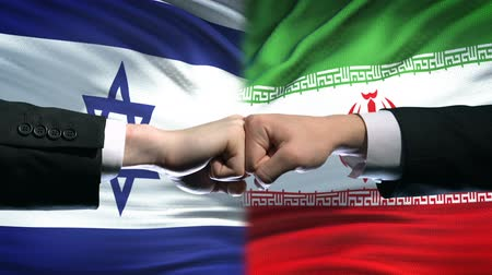 dispute : Israel vs Iran conflict, international relations, fists on flag background