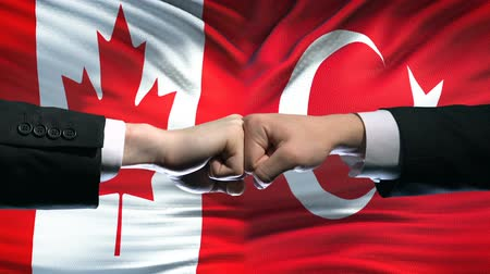 colision : Canada vs Turkey conflict, international relations, fists on flag background