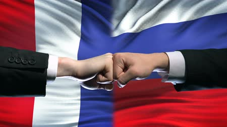 disputa : France vs Russia conflict, international relations, fists on flag background