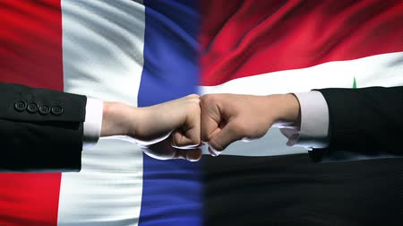 versengés : France vs Syria conflict, international relations, fists on flag background