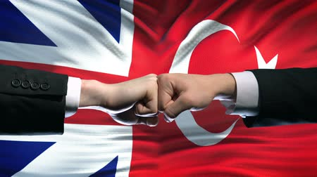 clash : Great Britain vs Turkey conflict, fists on flag background, diplomatic crisis Stock Footage
