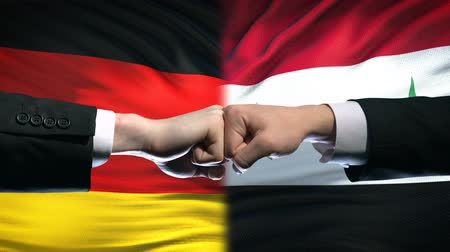 oposição : Germany vs Syria conflict, international relations, fists on flag background