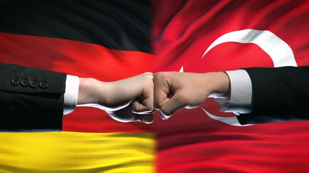 zahraniční : Germany vs Turkey conflict, international relations, fists on flag background