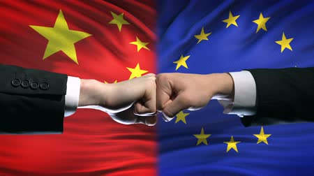 oposição : China vs EU conflict, international relations crisis, fists on flag background Vídeos