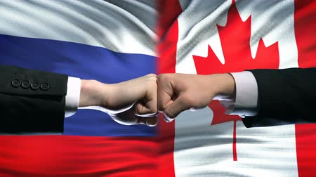 scontro : Russia vs Canada conflict, international relations, fists on flag background