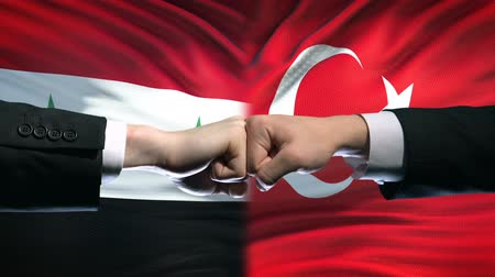 muhalefet : Syria vs Turkey conflict, international relations, fists on flag background Stok Video