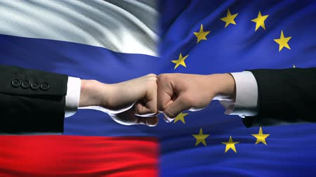 oposição : Russia vs EU conflict, international relations crisis, fists on flag background
