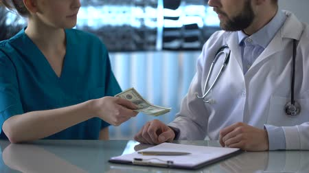 честный : Head physician refusing bribe at clinic, female intern giving money to doctor