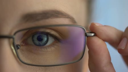 optometria : Female wearing eyeglasses and looking into camera, ophthalmic examination