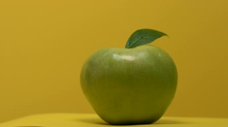 apple tree : Juicy apple turning on table, storage of vitamins and calcium, healthy nutrition