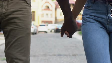 first person : Happy couple holding hands, strolling around city, young and carefree people Stock Footage