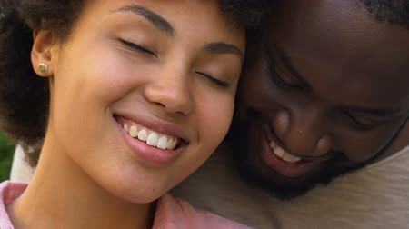 intimita : Happy afro american couple embracing and smiling, closeness, spiritual affinity