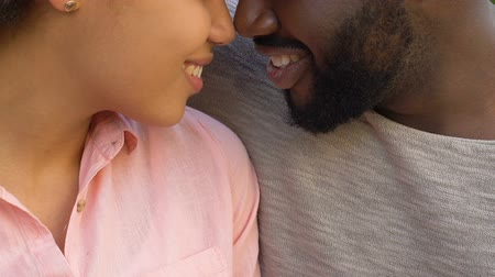 duyarlı : Afro-american couple nuzzling and embracing, happy together.