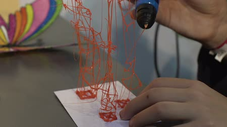 after school : Child creating 3d toy, three dimensional object, innovative technology at school Stock Footage