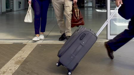 departing : People with suitcases leaving airport, arrival after business trip, vacations Stock Footage