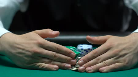 Ко : Croupier taking away winnings, illegal casino business, gambler losing property Стоковые видеозаписи
