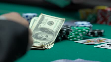 irresponsible : Professional gambler goes all-in, betting money and property. Stock Footage