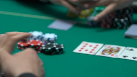 kombinasyon : Self-confident poker player making big bets.