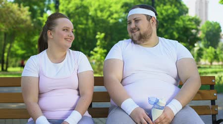 sustain : Obese insecure people laughing together, good mood as support in difficult times Stock Footage