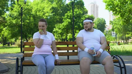 ajánlás : Obese couple discussing diet, healthy nutrition, common interest in weight loss