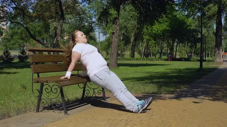 diligence : Obese girl exercising on bench in park, diligence, sport available in any place