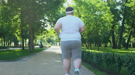 bodyweight : Fat man jogging in park, beginning of weight loss program, healthy lifestyle