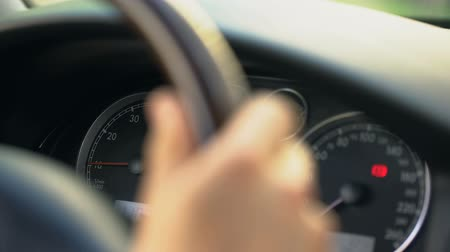 tachometer : Close up of dashboard and male hand steering wheel, driver stuck in traffic jam Stock Footage