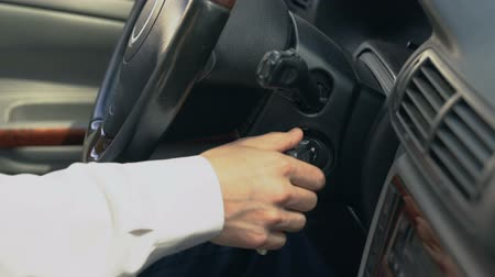 gearstick : Man starting car, shifting gear, chauffeur driving for client, taxi service