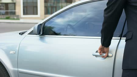 unlocking : Businessman turning off car alarm, getting into auto, safety system, insurance Stock Footage