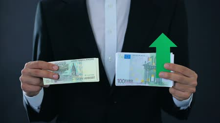 euro banknotes : Man holding banknotes, euro growing relative russian ruble, financial forecast