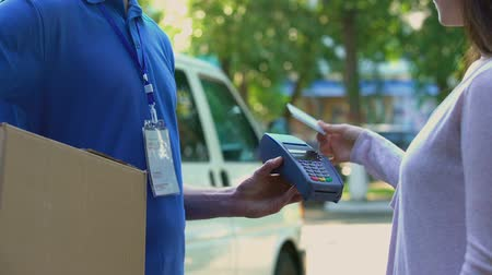 card pin : Delivery company client paying by contactless terminal for parcel transporting