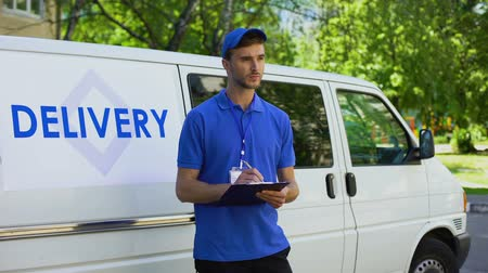 job transfer : Courier filling delivery blank, checklist report, postal service transportation Stock Footage