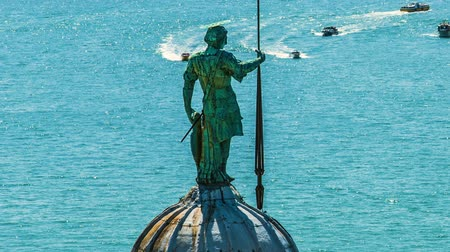 water taxi : Statue of St George standing on dome of cathedral, Grand Canal with boats