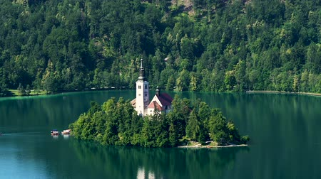 slovenya : Assumption of Mary church located on lake Bled, Slovenia travel, aerial view Stok Video