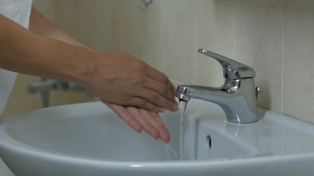 mosás : Lady carefully washing her hands with soap, hygiene, fight against microbes