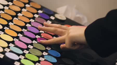tester : Girl applying eye shadow color hand, checking quality, beauty trends exhibition