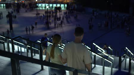 world cup : Couple walking downstairs, leaving stadium after football match, sporting event Stock Footage