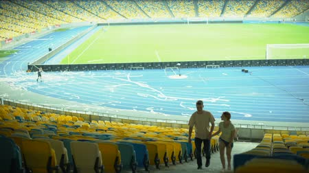 world cup : Couple of football fans leaving stadium after game, dating at sport event Stock Footage