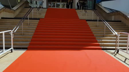 premiere : CANNES, FRANCE - CIRCA MAY 2018: 71st Cannes Film Festival. Red carpet on stairs of Cannes film festival palace, award ceremony, fame Stock Footage