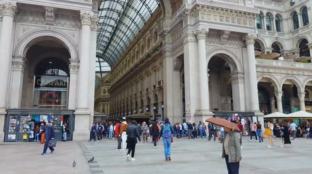 glass structure : MILAN, ITALY - CIRCA MAY 2018: Sightseeing in the city. People visiting Galleria Vittorio Emanuele, famous Milan sightseeing, entrance