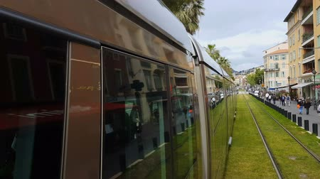 eco tourism : NICE, FRANCE - CIRCA MAY 2018: Sightseeing in the city. City train moving on railways, passengers transportation, eco-friendly vehicle Stock Footage