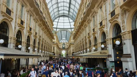 milan fashion : MILAN, ITALY - CIRCA MAY 2018: Shopping in the city. Tourists walking in Galleria Vittorio Emanuele, Milan luxury shopping, fashion