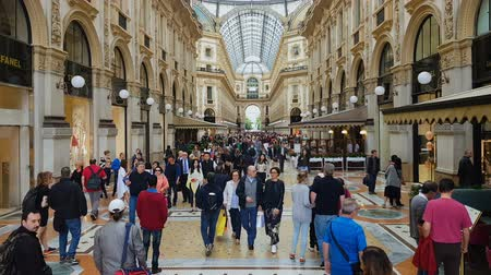 antiquariato : MILAN, ITALY - CIRCA MAY 2018: Shopping in the city. People shopping in famous Vittorio Emanuele Galleria, luxury boutiques and cafes