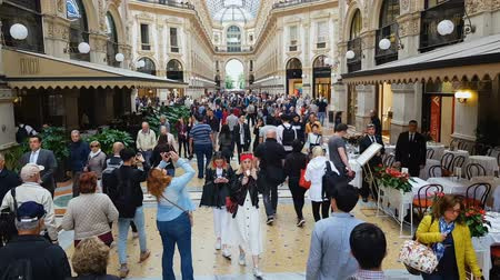 milan fashion : MILAN, ITALY - CIRCA MAY 2018: Shopping in the city. Visitors inside Milan shopping mall, Vittorio Emanuele Galleria design.