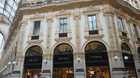 olasz kultúra : MILAN, ITALY - CIRCA MAY 2018: Shopping in the city. Luxury boutiques and ancient architecture details of Galleria Vittorio Emanuele