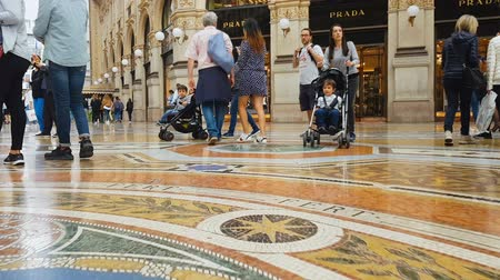 milan fashion : MILAN, ITALY - CIRCA MAY 2018: Shopping in the city. Customers walking in Galleria Vittorio Emanuele Milan, fashion trends, trade