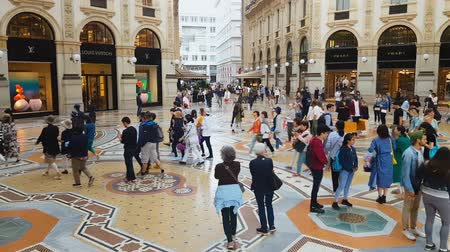 milan fashion : MILAN, ITALY - CIRCA MAY 2018: Shopping in the city. Tourists shopping in famous Milan city mall, Italian architecture, sightseeing