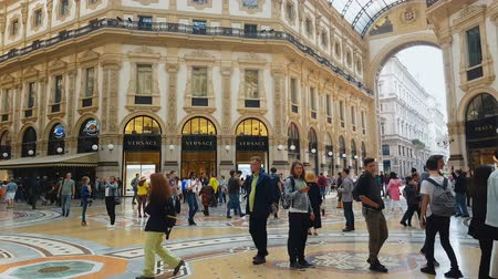 milan fashion : MILAN, ITALY - CIRCA MAY 2018: Shopping in the city. Famous shopping center in Milan, customers walking around, luxury boutiques.