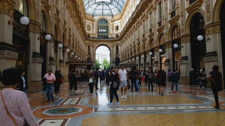 városháza : MILAN, ITALY - CIRCA MAY 2018: Shopping in the city. People walking in Galleria Vittorio Emanuele, major Milan landmark, architecture