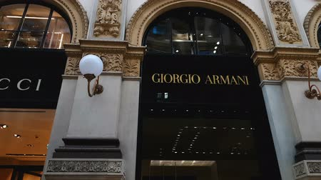 milan fashion : MILAN, ITALY - CIRCA MAY 2018: Shopping in the city. Gucci and Giorgio Armani boutiques in Galleria Vittorio Emanuele Milan, fashion